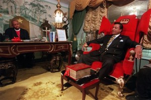 Reverend Ike in his opulent office